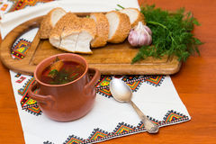 Ukrainian borsch and bread Stock Photos