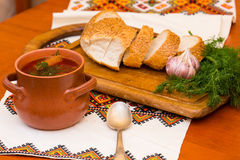 Ukrainian borsch and bread. Ukrainian soup and bread with vegetables on embroidered towel Royalty Free Stock Photo