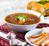 Ukrainian borsch with donuts. Onion and garlic royalty free stock photography