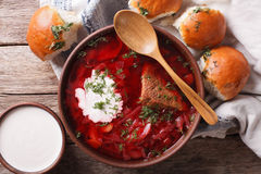 Ukrainian borsch soup and garlic buns close-up. Horizontal top v. Ukrainian borsch soup and garlic buns on the table close-up. Horizontal view from above royalty free stock image