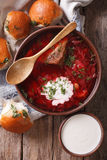 Ukrainian borsch soup and garlic buns close-up. vertical top vie Royalty Free Stock Photography