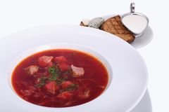 Ukrainian borsch with sour cream, bread with lard, the national dish. Photo Close-up on the white plate. stock image