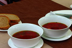 Ukrainian borsch. On the table there are two plates of Ukrainian borsch Royalty Free Stock Photography