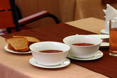 Ukrainian borsch. On the table there are two plates of Ukrainian borscht and bread Stock Photos