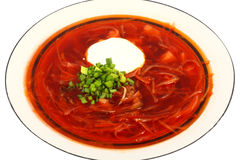 Ukrainian borscht. Meatless Ukrainian borsch with mushrooms and beans and sour cream Royalty Free Stock Photos