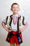 Ukrainian boy proud to wear traditional costume. Ukrainian cute boy posing with hands behind back proud to wear the traditional folk costume with short pants and stock photos