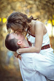 Ukrainian brides in traditional costumes embroidered shirts outdoors. Embrace and kiss stock images