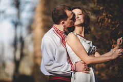 Ukrainian brides in traditional costumes embroidered shirts outdoors Stock Image