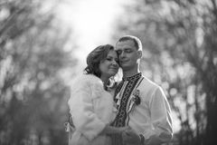 Ukrainian brides in traditional costumes embroidered shirts outdoors. Embrace in the park royalty free stock photos