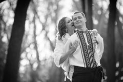 Ukrainian brides in traditional costumes embroidered shirts outdoors. Embrace tree stock photos