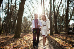 Ukrainian brides in traditional costumes embroidered shirts outdoors. Walking in the park stock photos