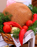 Ukrainian brown bread. Rural natural organic  Ukrainian brown  dark bread and vegetables in basket Royalty Free Stock Image