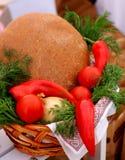 Ukrainian brown bread. Rural natural organic  Ukrainian brown  dark bread and vegetables in basket Stock Images