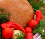Ukrainian brown bread and vegetables in basket. Rural natural organic  Ukrainian brown  dark bread and vegetables in basket Stock Image