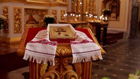 Ukrainian  cathedral. Beautiful icon in embroidered towels. Ukrainian style stock video footage