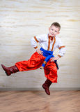Ukrainian child performing a traditional dance Royalty Free Stock Images