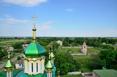 Ukrainian Christian church on the background of the village Royalty Free Stock Photography