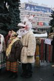 Ukrainian christmas festival. LUTSK, UKRAINE - January 11, 2009 - Man dressed as `The Goat` and group of women at traditional christmas festival at Teatralna Stock Images