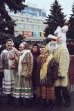 Ukrainian christmas festival. LUTSK, UKRAINE - January 11, 2009 - Man dressed as `The Goat` and group of women at traditional christmas festival at Teatralna Stock Photography