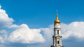 Ukrainian church in the sky with clouds. Kharkov cathedral in cloudy sky Stock Photos