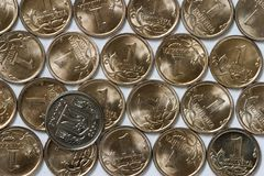 Ukrainian coin over russian coins Stock Photo