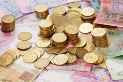 Ukrainian coins on banknotes. Background close up Royalty Free Stock Photo