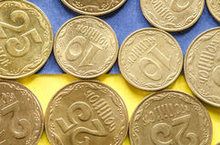 Ukrainian coins on blue and yellow Stock Images