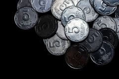 Ukrainian coins isolated on black background. Close-up view. Coins are located above the right side of frame. royalty free stock images