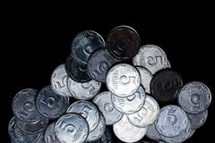 Ukrainian coins isolated on black background. Close-up view. Coins are located below the center of frame. royalty free stock images