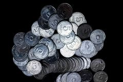 Ukrainian coins isolated on black background. Close-up view. Coins are located in the center of frame. stock photo