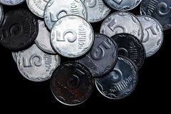 Ukrainian coins isolated on black background. Close-up view. Coins are located above the center of frame. royalty free stock photo