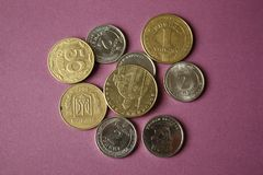 Ukrainian coins isolated on purple background. Close-up. Conceptual image stock photos