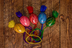 Ukrainian colored Easter eggs with ornaments on a wooden background Royalty Free Stock Photos