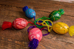 Ukrainian colored Easter eggs with ornaments on a wooden background Stock Image