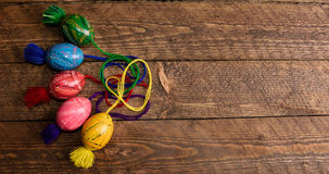 Ukrainian colored Easter eggs with ornaments on a wooden background Stock Photos