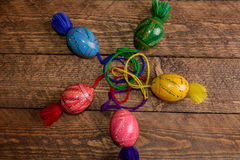 Ukrainian colored Easter eggs with ornaments on a wooden background Royalty Free Stock Image