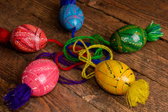 Ukrainian colored Easter eggs with ornaments on a wooden background Stock Photo