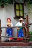 Ukrainian Cossack Dolls. Ukrainian Cossack Couple Dolls Near Traditional House Royalty Free Stock Photo