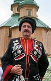 Ukrainian cossack general 2. Ukrainian cossack general under wooden church Royalty Free Stock Photography