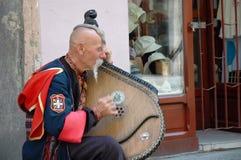 Ukrainian cossak playing on his bandura instrument Royalty Free Stock Image