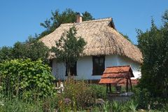Ukrainian country house. Traditional house in ukrainian country with well Royalty Free Stock Image