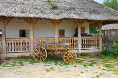 Ukrainian countryside. Typical Ukrainian courtyard with old cart in farm Royalty Free Stock Images