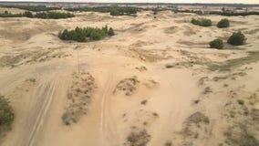 Ukrainian Desert Oleshky Sands Aerial Footage. Lateral flight above ukrainian semi-desert `Oleshky Sands` with racing tracks and some vegetation 4K, 25fps stock footage