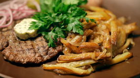 A ukrainian dish. Potatoes, potato pancakes and onions with parsley. A national dish of Ukrainian cuisine. There are French fries, cutlets, parsley and the stock footage