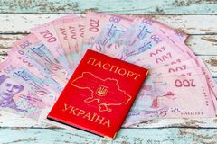 Ukrainian domestic passport with hryvnias Royalty Free Stock Photo