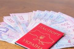 Ukrainian domestic passport with hryvnias Stock Images