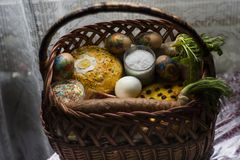 Festive Basket of the Greatest Ukrainian Easter holiday. Ukrainian Easter basket filled with traditional festive dishes and who blessed the feast Stock Image