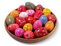 Ukrainian Easter Colorful  Eggs in a  wooden plate. Ukrainian Easter Colorful  Eggs - pysanky in a  wooden plate  on a white background Stock Photography