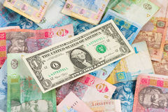Ukrainian economic crisis: currency rate hryvnia to dollar. Currency exhange concept. American one dollar on ukrainian money background Stock Photos