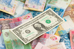 Ukrainian economic crisis: currency rate hryvnia to dollar. Currency exhange concept. American one dollar on ukrainian money background Royalty Free Stock Image
